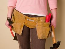 Toolbelt. Girl wearing a toolbelt Royalty Free Stock Photos