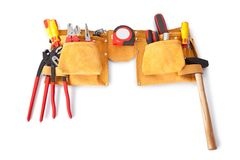 Toolbelt with various tools. Lying on the bench Royalty Free Stock Photography