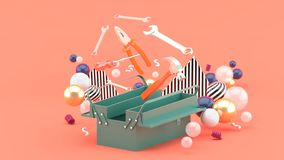 Toolbox amidst colorful balls on a pink background. stock illustration