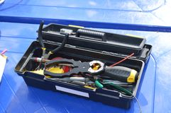 Toolbox on blue surface for electrician or mechanic royalty free stock images