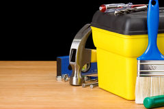 Toolbox and construction tools  on black Royalty Free Stock Photos