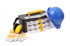 Toolbox with earmuffs gloves and hardhat. Royalty Free Stock Images