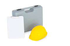 Toolbox, hardhat and clipboard on white background Stock Image