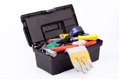 Toolbox med handskar arkivfoto