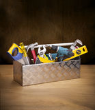 Toolbox Tools Toolkit Wood Box. A toolbox full of tools on a wood surface and brown background. Can be paired with similar image No: 23351545 Royalty Free Stock Photo