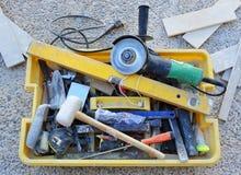 Toolbox wanordelijk van een metselaar stock foto
