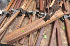 The tooling. Old wooden plane and hammers on a wood table Royalty Free Stock Photography