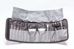 Toolkit auf der grauen Tasche lokalisiert auf Weiß lizenzfreie stockbilder