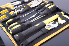 Toolkit black and yellow. On black table Royalty Free Stock Photo