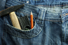 Toolkit of Three items in a blue jeans pocket. Toolkit of Three items in a blue jeans pocket Royalty Free Stock Photo