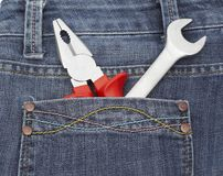 Toolkit of two items in a blue jeans pocket Royalty Free Stock Images