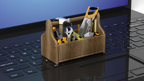 Toolkit with various tools on laptops Royalty Free Stock Photo