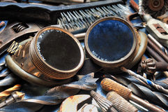 Tools. Welding goggles between used industrial tools Royalty Free Stock Photos