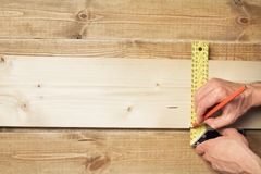 Tools. Carpenter with a measuring tool and a pencil Royalty Free Stock Image