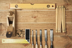 Tools. Set of different tools on a wooden planks Royalty Free Stock Photos