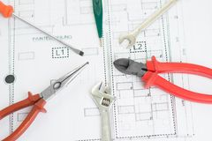 Tools. Close-up image of technical tools lying arranged over a blueprint stock photography