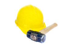 Tools. Yellow Hardhat and sledge hammer Royalty Free Stock Image