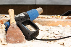 Tools. Heat gun and scraper for removing old paint during window renovation Royalty Free Stock Photos