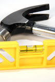 Tools. Yellow level and hammer on a white background Royalty Free Stock Photo