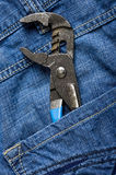 Tools. Texture jeans with work tools Royalty Free Stock Images