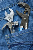 Tools. Texture jeans with work tools Royalty Free Stock Photos
