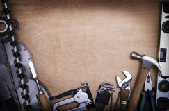 Tools. On a wooden background Stock Photos