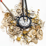 Tools above watch on heap of spare parts Stock Image