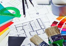 Tools and accessories for home renovation. On an architectural drawing Royalty Free Stock Image
