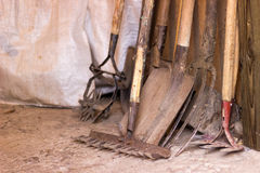 Tools for agriculture are rustic garage, shovel, rake and the other garden items Royalty Free Stock Photography