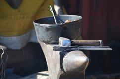 Tools of an ancient blacksmith shop Stock Photos