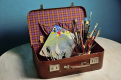 Tools of the artist in a suitcase Stock Images