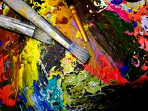 Tools of an artist, three old brushes on the palette Royalty Free Stock Images
