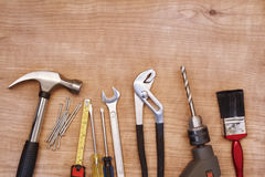 Tools. Assorted work tools on wood Royalty Free Stock Images