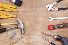 Tools. Assorted work tools on wood Stock Photos