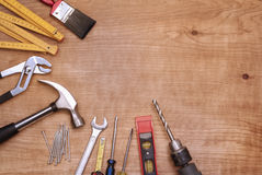 Tools. Assorted work tools on wood Royalty Free Stock Photo