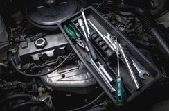 Tools of auto mechanic with engine Royalty Free Stock Photography