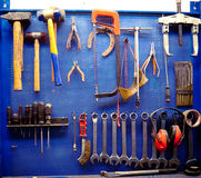 Tools in auto repairs shop. The tyre workshop part. Mallets, hammers, ratchet combination wrenches in many sizes, pliers, screwdrivers and so on. Slight cross Stock Photography