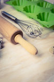 Tools for baking of muffins or cupcakes on wooden background Stock Photography