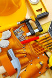 Tools in belt and hardhat Stock Photo