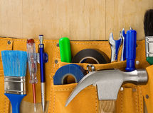 Tools in belt on wood Stock Image
