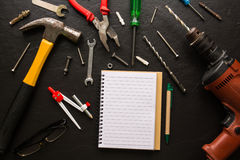 Tools on a black background. A tool is any physical item that can be used to achieve a goal, especially if the item is not consumed in the process. Tool use by Royalty Free Stock Images