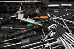 Tools. On black box background ,focusing on brass air gun Stock Images