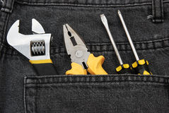 Tools in a black jean Royalty Free Stock Images