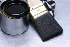 Tools Black Paint and Paintbrush. On Metal Surface Royalty Free Stock Photo