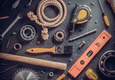 Tools on black table background, top view. Tools and instruments on black table background, top view stock photography