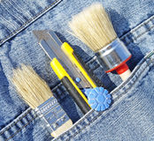 Brush and knife in pocket Stock Photo