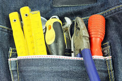 Tools in a blue jean pocket Stock Image