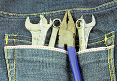 Tools in a blue jean pocket Royalty Free Stock Photography
