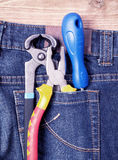Tools in blue jeans pocket Royalty Free Stock Images