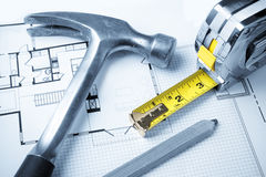 Tools on Blueprints. Including hammer, measuring tape, and construction pencil stock photos